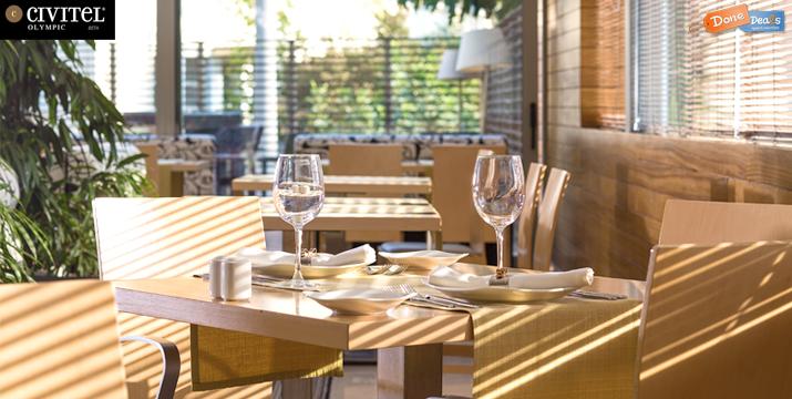 Γιορτινή προσφορά! Από 19€ για Ρεβεγιόν Πρωτοχρονιάς ή New Year's Brunch, στο ξενοδοχείο Civitel Olympic Hotel. Tο ανακαινισμένο Roof Garden με τη μαγευτική θέα, σας περιμένει σε μια γιορτινή ατμόσφαιρα γεμάτη μουσική και εντυπωσιακούς μπουφέδες που εμπνεύστηκε ο Executive Chef Κώστας Γεωργατζάς!
